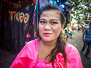 """27 NOVEMBER 2012 - BANGKOK, THAILAND:  The """"shill"""" who draws people into the haunted house at the Wat Saket Temple Fair in Bangkok. Wat Saket, popularly known as the Golden Mount or """"Phu Khao Thong,"""" is one of the most popular and oldest Buddhist temples in Bangkok. It dates to the Ayutthaya period (roughly 1350-1767 AD) and was renovated extensively when the Siamese fled Ayutthaya and established their new capitol in Bangkok. The temple holds an annual fair in November, the week of the full moon. It's one of the most popular temple fairs in Bangkok. The fair draws people from across Bangkok and spills out in the streets around the temple.   PHOTO BY JACK KURTZ"""