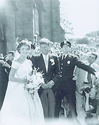 """John and Jacqueline Kennedy unpublished Wedding Photos up for sale<br /> <br /> A collection of 13 original and most likely unpublished negatives from the wedding of John F. and Jacqueline Kennedy will be auctioned by Boston, MA based RR Auction in October.<br /> <br /> """"The images were taken by a freelance photographer, Arthur Burges, of Fall River, MA who had been asked to be a 'back-up' photographer for the wedding,"""" says Bobby Livingston, Exec VP at RR Auction. """"They were discovered by family members in his darkroom after his passing in 1993."""" <br /> <br /> John and Jacqueline Kennedy were married on September 12, 1953, at St. Mary's Church in Newport, Rhode Island. The wedding was considered the social event of the season with an estimated 700 guests at the ceremony and 1,200 at the reception that would follow. The entire event was chronicled by Life magazine, which noted 'their wedding turned out to be the most impressive the old society stronghold had seen in 30 years.'<br /> <br /> Each negative measures 3.75 x 5, four feature the newlywed couple, two show the entire wedding party, and the remainder show the cake, reception, and wedding attendees.<br /> <br /> Negatives are housed in their original folder, labeled at a later date, """"Pres. Kennedy 1953."""" Accompanied by 5 x 4 printouts of each negative, the very first prints that have been made from these negatives.<br /> ©RR Auction/Exclusivepix"""