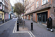 With very few people out and about the scene at Neal Street in Covent Garden is one of empty desolation as the national coronavirus lockdown three continues on 29th January 2021 in London, United Kingdom. Following the surge in cases over the Winter including a new UK variant of Covid-19, this nationwide lockdown advises all citizens to follow the message to stay at home, protect the NHS and save lives.