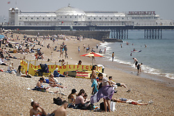 © Licensed to London News Pictures. 24/06/2021. Brighton, UK. Visitors to Brighton enjoy the warm weather on the beach. After recent rain, a period of high temperatures and sunshine is forecast in the south. Photo credit: Peter Macdiarmid/LNP