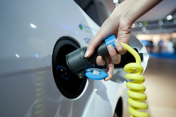 Recharging Ford electric car using plug in charger at Frankfurt Motor Show 2009