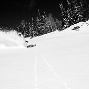 Tanner Flanagan skis blue bird powder in the backcountry near Jackson Hole Mountain Resort, Wyoming.