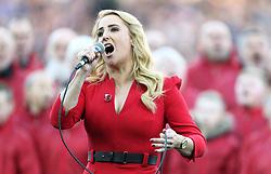 Lizzie Jones sings the national anthem prior to kick-off