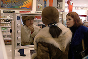Moscow, Russia, 14/02/2004..Customers and staff at one of the Arbat Prestige chain of perfumery and cosmetic stores.
