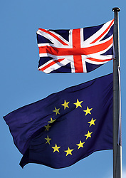 """Embargoed to 0001 Thursday June 1 File photo dated 31/3/2017 of the Union flag and the EU flag. The European Union has """"far more to lose"""" from a """"no deal"""" with the UK in its forthcoming Brexit negotiations compared to a """"no deal"""" with Greece, a British policy think tank report has suggested."""