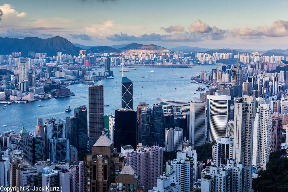 11 AUGUST 2013 - HONG KONG: Kowloon (left) and Hong Kong separated by Victoria Harbor. Hong Kong is one of the two Special Administrative Regions of the People's Republic of China, Macau is the other. It is situated on China's south coast and, enclosed by the Pearl River Delta and South China Sea, it is known for its skyline and deep natural harbour. Hong Kong is one of the most densely populated areas in the world, the  population is 93.6% ethnic Chinese and 6.4% from other groups. The Han Chinese majority originate mainly from the cities of Guangzhou and Taishan in the neighbouring Guangdong province.      PHOTO BY JACK KURTZ