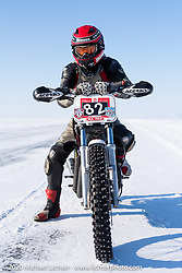 Mikhail Lyubimov with his Harley-Davidson Sportster that he got to 164 kmh (102 mph) on the mile-long ice track in the Baikal Mile Ice Speed Festival. Maksimiha, Siberia, Russia. Friday, February 28, 2020. Photography ©2020 Michael Lichter.