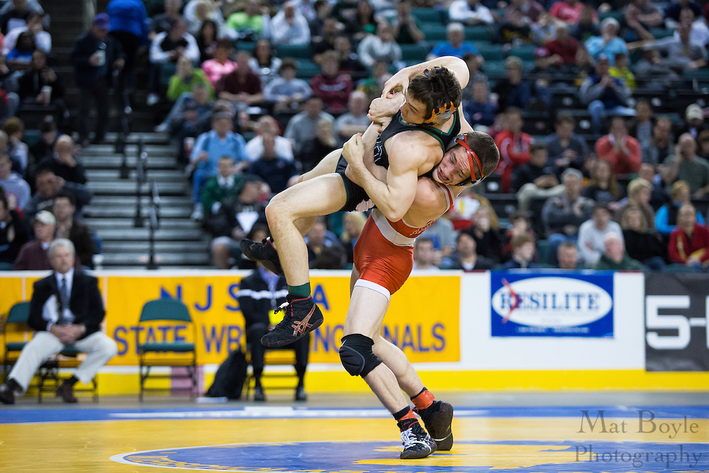 T.J. Miller of Camden Catholic defeats .Jason Gaccione of High Point (red).145 lb 3rd place match in the NJ State Wrestling Tournament at Boardwalk Hall in Atlantic CIty, NJ on Sunday March 10, 2013. (photo / Mat Boyle)