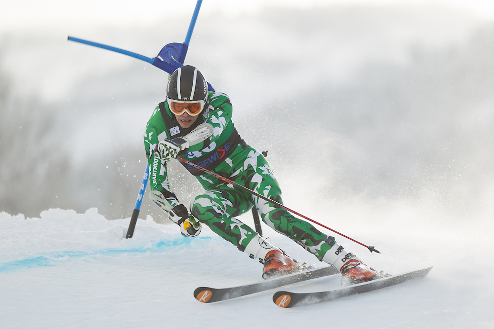 Sam Macomber of Dartmouth College, skis during the first run of the men's giant slalom at the Colby College Carnival at Sugarloaf Mountain on January 17, 2014 in Carabassett Valley, ME. (Dustin Satloff/EISA)