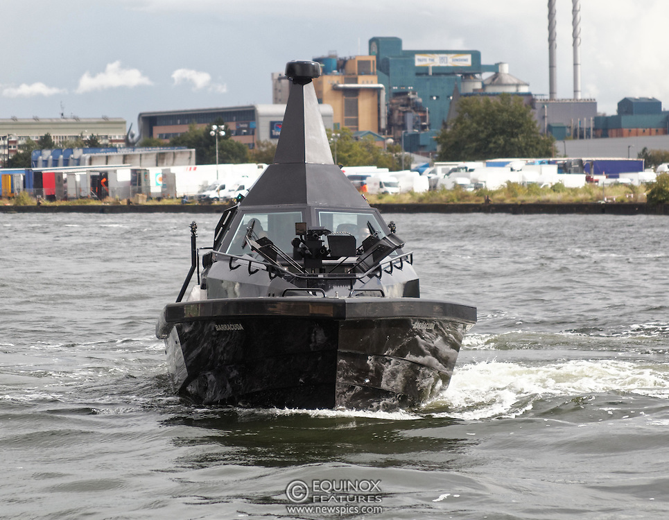 London, United Kingdom - 18 September 2015<br /> Safehaven Marine demonstrate their SV11 Barracuda stealth boat with front mounted retractable gun and radar avoidance technology at Operation MARICAP waterborne demonstration at the defence and security exhibition DSEI at ExCeL, Woolwich, London, England, UK.<br /> (photo by: EQUINOXFEATURES.COM)<br /> <br /> Picture Data:<br /> Photographer: Equinox Features<br /> Copyright: ©2015 Equinox Licensing Ltd. +448700 780000<br /> Contact: Equinox Features<br /> Date Taken: 20150918<br /> Time Taken: 14344129<br /> www.newspics.com