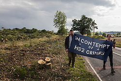 Anti-HS2 activists carry a banner along the Fosse Way on 24th August 2020 in Offchurch, United Kingdom. Environmental activists based at wildlife protection camps in Warwickshire have been trying to prevent or delay the felling of large numbers of trees in connection with the £106bn HS2 high-speed rail link, which will destroy or significantly impact many irreplaceable natural habitats including 108 ancient woodlands.