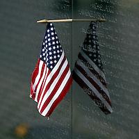 Jun 14, 2004; Washington DC, Washington, USA;  Flag Day. American Flag hangs at the Vietnam Veterans War Memorial inside Constituion Gardens.  United States statue landmark.
