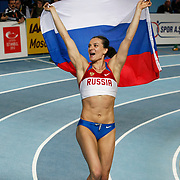 Gold medalist Yelena Isinbayeva of Russia holds her national flag after the women's pole vault final during the IAAF World Indoor Championships at the Atakoy Athletics Arena, Istanbul, Turkey. Photo by TURKPIX