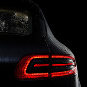Rear back brake light on Porsche car with water droplets, Ray Massey is an established, award winning, UK professional photographer, shooting creative advertising and editorial images from his stunning studio in a converted church in Camden Town, London NW1. Ray Massey specialises in drinks and liquids, still life and hands, product, gymnastics, special effects (sfx) and location photography. He is particularly known for dynamic high speed action shots of pours, bubbles, splashes and explosions in beers, champagnes, sodas, cocktails and beverages of all descriptions, as well as perfumes, paint, ink, water – even ice! Ray Massey works throughout the world with advertising agencies, designers, design groups, PR companies and directly with clients. He regularly manages the entire creative process, including post-production composition, manipulation and retouching, working with his team of retouchers to produce final images ready for publication.