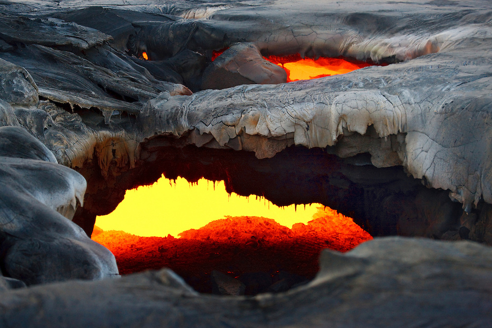 A collapsed roof allows a peek at the main river of lava supplying the Waikupanaha entry.