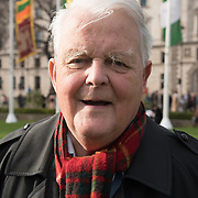 Bruce Kent of Campaign for Nuclear Disarmament speaks against air strikes in Syria and violate international law  is attended by several hundred people in Parliament Square, London, UK