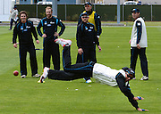 Cricket- Black Caps training session, 01 December 2013<br /> <br /> Trent Boult of the Black Caps dives for the ball during a training session watched by from left  BJ Watling, Aaron Redmond, Brendon McCullum, Peter Fulton, Doug Bracewell of the Black Caps New Zealand at the University Oval, Dunedin on Sunday 1st December 2013.<br /> Photo: Jane Dawber/Photosport.co.nz