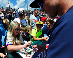Chase Utley signs an autograph for Kassidy Nester, 9 of Whitehall. Philadelphia Phillies 2nd baseman Chase Utley rehabs with the Lehigh Valley IronPigs in a game against the Norfolk Tides August 2nd, 2015, at Coca-Cola Park in Allentown.
