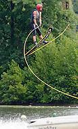 sports; recreation; water sports; water ski; ski jump; tow rope; flying; extreme sport; water; lake; summer; Northeast; speed; helmet; daring, high,