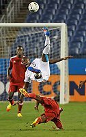 NASHVILLE, TN - MARCH 22:  Kofi Sarkodie #3 of the USA goes up for a ball in against Cuba in a MenÕs Olympic Qualifying match at LP Field on March 22, 2012 in Nashville, Tennessee.  (Photo by Frederick Breedon/Getty Images)