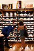 Customer in Wine Department at Dallmayr food store in Munich, Bavaria, Germany