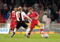 Photo: Leigh Quinnell.<br /> Swindon Town v Grimsby Town. Coca Cola League 2. 14/10/2006. Swindons Michael Pook gets the ball past Grimsbys Paul Bolland.