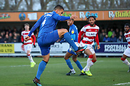 AFC Wimbledon defender Rod McDonald (4) controlling the ball in the box during the EFL Sky Bet League 1 match between AFC Wimbledon and Doncaster Rovers at the Cherry Red Records Stadium, Kingston, England on 14 December 2019.