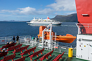 A cruise ship passes us on the Stornoway–Ullapool ferry nearing Ullapool. The Highlands of Scotland, UK, Europe.