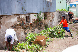 Volunteers clean up brush around the Garden Street gut.  Residents and volunteers gather for the Garden Street neighborhood cleanup and block Party hosted by E's Garden and Things, Long Path/Garden Street Community Association, and the Economic Development Authority's Enterprise and Commerical Zone Commission.  St. Thomas, USVI.  5 September 2015.  © Aisha-Zakiya Boyd