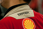 An employee wearing a shirt with a Ferrari logo is seen at the company plant in Maranello, Italy, on Monday, July 18, 2011.<br /> Photo: Victor Sokolowicz / Bloomberg