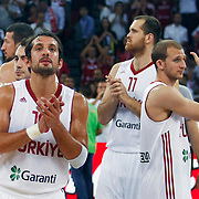 Turkey's Sinan GULER (R) and Kerem TUNCERI (L) celebrate victory during their Istanbul CUP 2011match played Montenegro between Turkey at Abdi Ipekci Arena in Istanbul, Turkey on 25 August 2011. Photo by TURKPIX