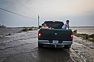 Isle de Jean Charles residnets headed to Isle de Jean Charles on a flooded Island Road on April 13, 2019.