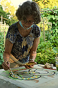 Artist Judy Ballinger paints for Pretzel Project, Berks Co., West Reading, PA