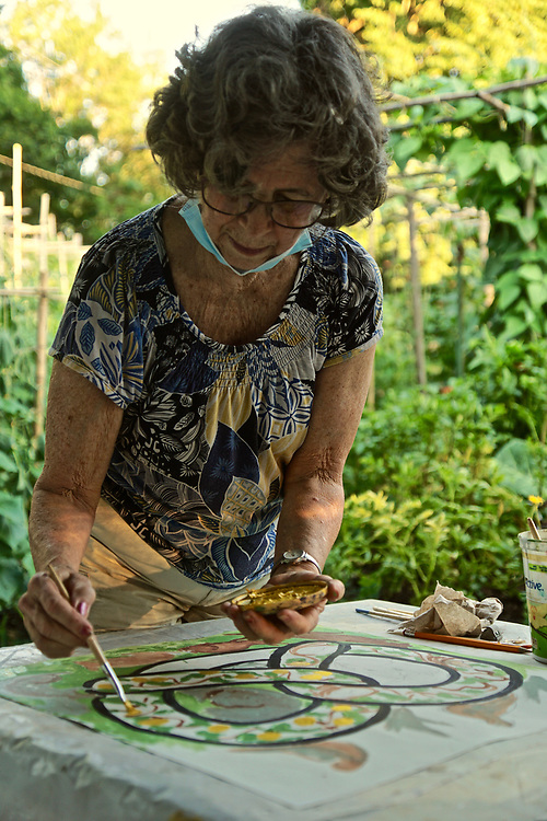 Artist Judy Ballinger paints for Pretzel Project, Berks Co., West Reading, PA