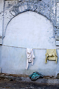 Washing hangs on the line inside the Chiragh-i-Delhi Dargah. Nasiruddin Mahmud Chirag-e-Delhi was a 14th century mystic-poet and a Sufi saint of the Chishti Order.