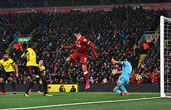 Liverpool's Roberto Firmino scores his sides third goal during the Premier League match at Anfield, Liverpool.