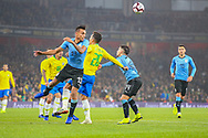 Uruguay defender Matias Vecino (13) beats Brazil forward Roberto Firmino (20) to a header during the Friendly International match between Brazil and Uruguay at the Emirates Stadium, London, England on 16 November 2018.