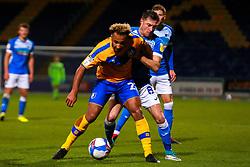 John Rooney of Barrow puts pressure on Nicky Maynard of Mansfield Town - Mandatory by-line: Ryan Crockett/JMP - 27/10/2020 - FOOTBALL - One Call Stadium - Mansfield, England - Mansfield Town v Barrow - Sky Bet League Two
