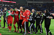 Ashley Williams (l) and Gareth Bale lead the celebrations after the match as the Wales team qualify for Euro 2016 finals in France.  Wales v Andorra, Euro 2016 qualifying match at the Cardiff city stadium  in Cardiff, South Wales  on Tuesday 13th October 2015. <br /> pic by  Andrew Orchard, Andrew Orchard sports photography.