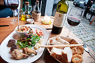 Maltese appetiser restaurant meal with wine and bread.
