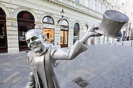 'Schoene Naci' ('Handsome Ignatius', based on local resident Ignac Lamar), one of several humorous statues which grace the streets of the Slovak capital, on the Korzo, Bratislava, Slovakia