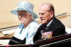 Queen Elizabeth II and the Duke of Edinburgh arrive for the Trooping the Colour ceremony at Horse Guards Parade, central London, as the Queen celebrates her official birthday.