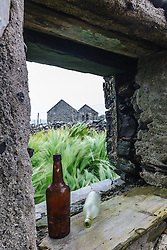 Bottles in window of abandoned house, Barnabaun Point, County, Mayo, Ireland
