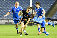 Darcy Graham under pressure during the Guinness Pro 14 2018_19 match between Edinburgh Rugby and Dragons Rugby at Murrayfield Stadium, Edinburgh, Scotland on 15 February 2019.
