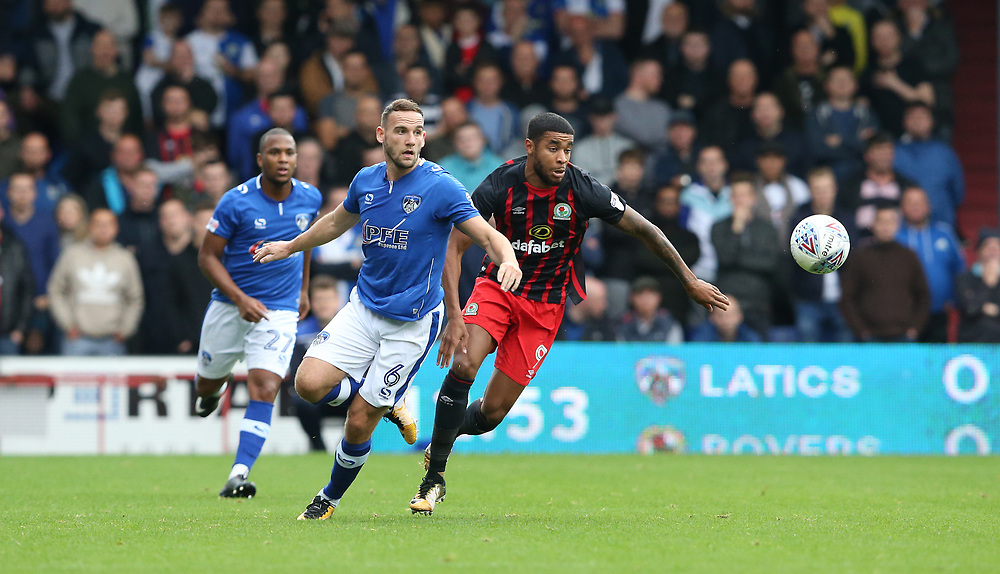 Oldham Athletic's Dan Gardner and Blackburn Rovers' Dominic Samuel<br /> <br /> Photographer Stephen White/CameraSport<br /> <br /> The EFL Sky Bet League One - Oldham Athletic v Blackburn Rovers - Saturday 14th October 2017 - Boundary Park - Oldham<br /> <br /> World Copyright © 2017 CameraSport. All rights reserved. 43 Linden Ave. Countesthorpe. Leicester. England. LE8 5PG - Tel: +44 (0) 116 277 4147 - admin@camerasport.com - www.camerasport.com