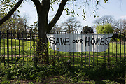 Gentrification protest banners in Cressingham Gardens on 18th April 2015 in South London, United Kingdom. Cressingham Gardens is a council garden estate, located on the southern edge of Brockwell Park. It comprises of 306 dwellings and built to the design of Lambeth Borough Council architect Edward Hollamby in the early 1970s. In 2012, Lambeth Council proposed regeneration of the estate, a decision highly opposed by many residents. Since the announcement, the highly motivated campaign group Save Cressingham Gardens has been active.