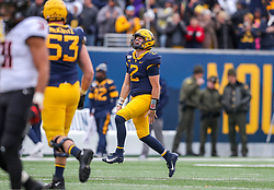 Nov 23, 2019; Morgantown, WV, USA; West Virginia Mountaineers quarterback Jarret Doege (2) celebrates after throwing a touchdown pass to West Virginia Mountaineers wide receiver George Campbell (15) during the second quarter against the Oklahoma State Cowboys at Mountaineer Field at Milan Puskar Stadium. Mandatory Credit: Ben Queen-USA TODAY Sports