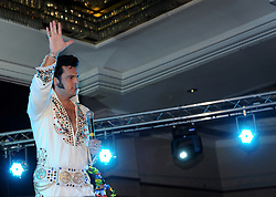 © Licensed to London News Pictures. 07/01/2012. BIRMINGHAM, UK.  Jean Bayoux, who has travelled from France sings to the crowds as he takes part in the annual European Elvis Championship at the Hilton Metropole Hotel at the National Exhibition Centre today.  Photo credit: Alison Baskerville/LNP