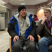 Date: 2/6/15<br /> Desk: SCI<br /> Slug: SUPER UTILIZERS<br /> Assign Id: 30170556A<br /> <br /> TJ Redig, 28, right, a case manager for the Hennepin Health RESOURCE Chemical and Mental Health emergency department in reach program in Minneapolis (Hennepin County), Minnesota sits with his client Prugh Jose, 42, who is homeless, after a scheduled dental appointment at the Hennepin County Medical Center's Dental & Oral Surgery Clinic on February 6, 2015. <br /> <br /> Photo by Angela Jimenez for The New York Times <br /> photographer contact 917-586-0916