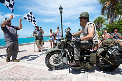 Randy Samz riding his 1942 Harley-Davidson WLA during the over the finish line of the Cross Country Chase motorcycle endurance run from Sault Sainte Marie, MI to Key West, FL. (for vintage bikes from 1930-1948). The Grand Finish in Key West's Mallory Square after the 110 mile Stage-10 ride from Miami to Key West, FL and after covering 2,368 miles of the Cross Country Chase. Sunday, September 15, 2019. Photography ©2019 Michael Lichter.